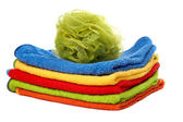Multicolour towels stacked and body sponge — Stock Photo