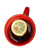 Red cup of tea with lemon — Stock Photo