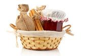 Jam jar, sticks of cinnamon and burlap — Stock Photo