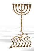 Menorah reflected on water — Zdjęcie stockowe