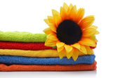 Artificial flower on towels — Stock Photo