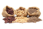 Lentils, chickpeas and red beans spilling out — Stock Photo