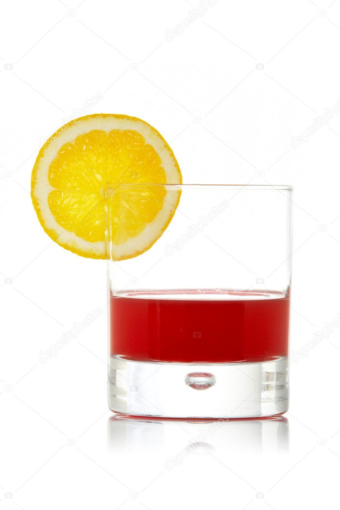 A glass of red juice with a lemon slice, reflected on white background  Stock Photo #6340009