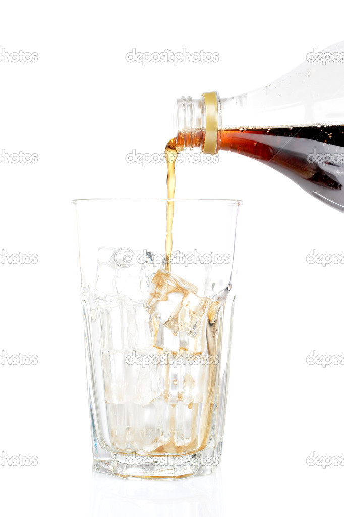 Pouring soda into a empty glass with ice cubes, reflected on white background. Shallow DOF — Stock Photo #6340417
