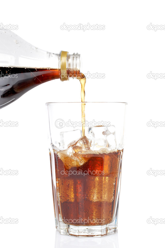 Pouring soda into a glass with ice cubes, reflected on white background. Shallow DOF — Stock Photo #6340421