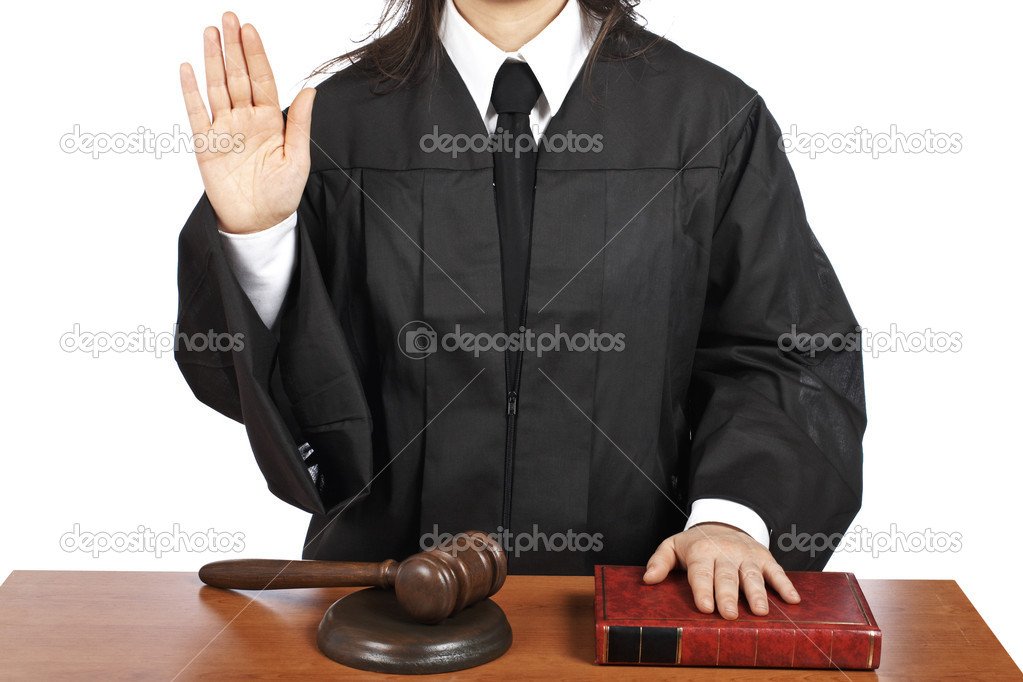 A female judge taking oath in a courtroom, isolated on white background. Shallow depth of field — Stock Photo #6341173