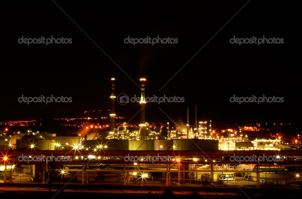 Night view of a petrochemical refinery with chimneys and storage tanks  Stock Photo #6342562