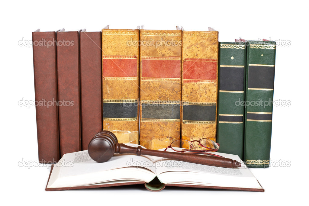 Wooden gavel from the court and law books isolated on white background. Shallow depth of field  Stock Photo #6345324