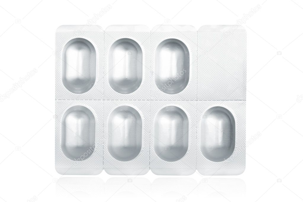 Blister pack containing medical pills reflected on white background — Stock Photo #6345419
