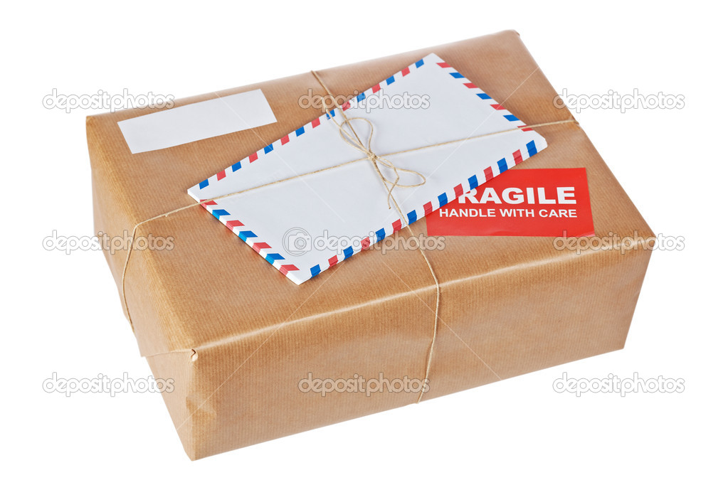 A fragile parcel wrapped in brown paper and tied with rough twine, isolated on white background. Shallow depth of field — Stock Photo #6347037
