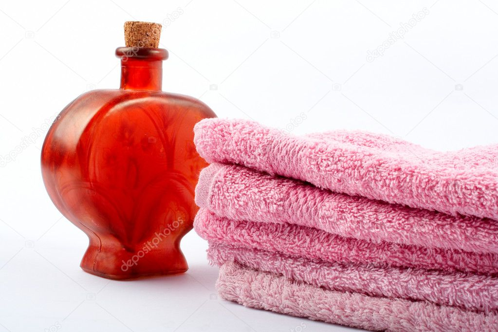 Towels and fragrance bottle on white background — Stock Photo #6347706