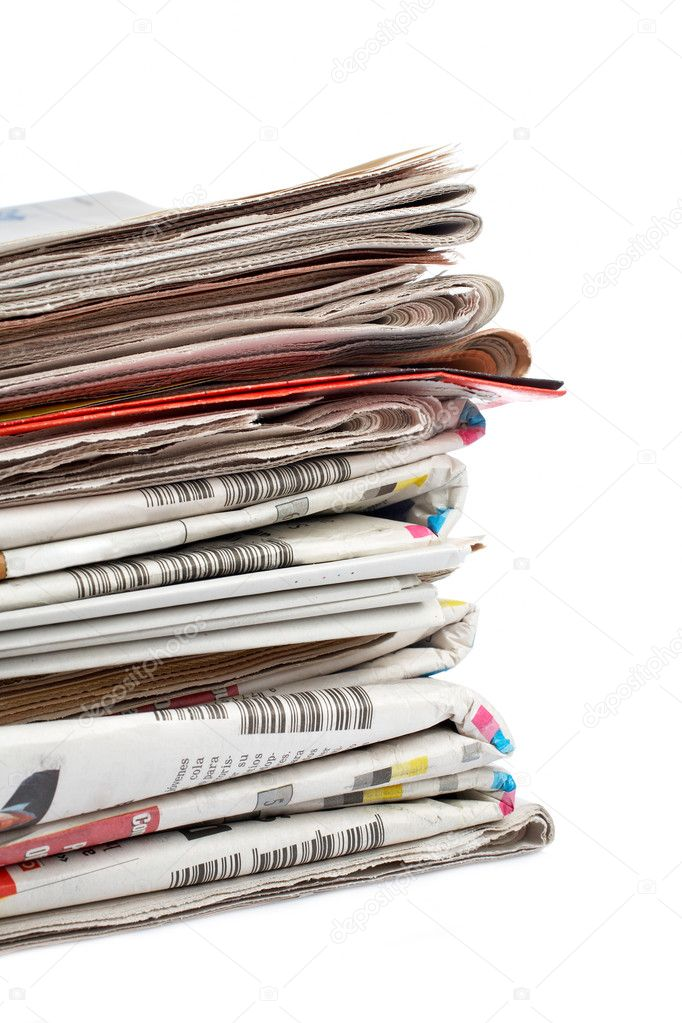 A stack of local newspapers with focus on front. Shallow DOF — Stock Photo #6348853