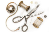 Tailor's tools - scissors, measuring tape, thimble, etc. - on white — Stock Photo