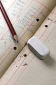 Pencil with eraser on a notebook — Stock Photo
