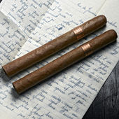 Couple of cuban hand-rolled cigars a letter — Stock Photo