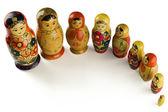 Babushka dolls on white — Stock Photo