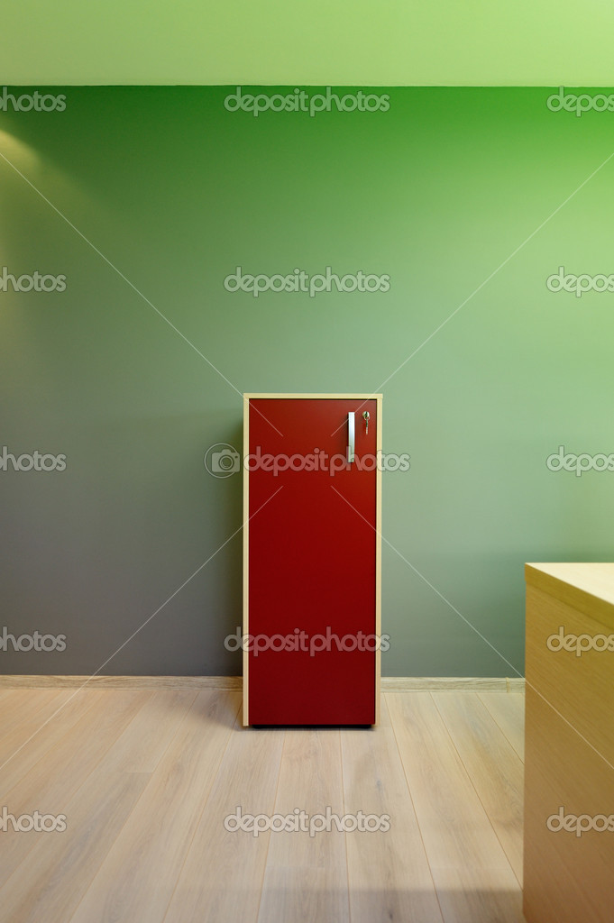 This photograph represents a filing cabinet in a modern minimalist office with abstract green gand gray background. Great file for your project about your new o — Stock Photo #5968144