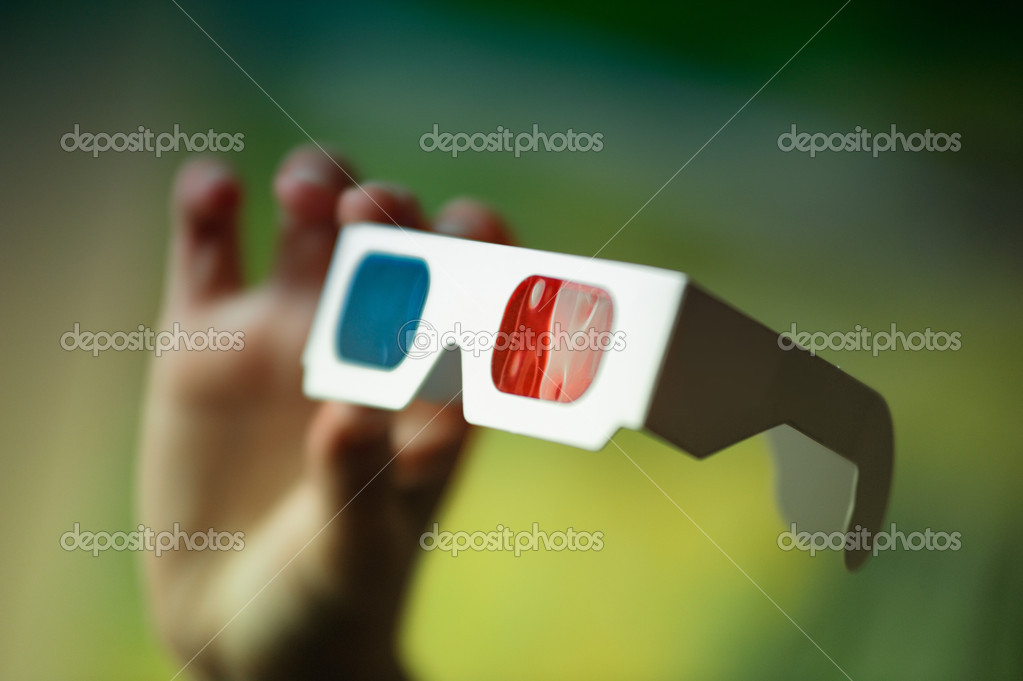 This photograph represents a hand holding 3D-Glasses. Great file for your cinema, museum and other business. — Stock Photo #5968221