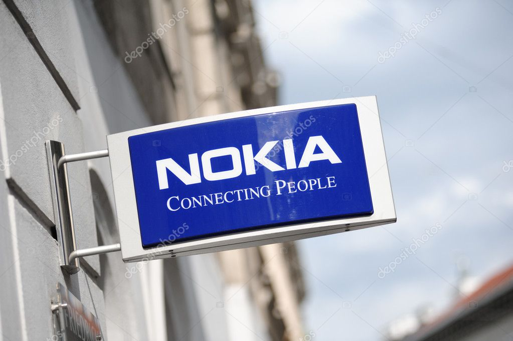 Helsinki, Finland - July 07, 2011: Sign of the NOKIA store in Helsinki, Finland.  Nokia is engaged in the manufacturing of mobile devices and in converging Inte  Stock Photo #6245779