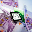 Watch on top of Euro bills - Stock Photo