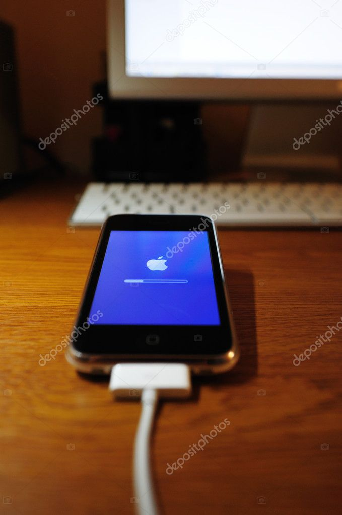 This photograph represent an Apple Iphone software update procedure.   Stock Photo #6403061