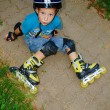 Stock Photo: Boy fell roller skates
