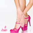 French manicure, high heels and pink flowers — Stock Photo