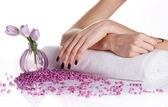 Spa manicure with lilac flowers — Stock Photo