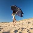 Woman with blue parasol — Stock Photo