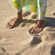 Feet and beach wrap — Stock Photo