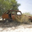 Dilapidated car side — Stockfoto