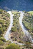 Car at rural road curve — Stock Photo
