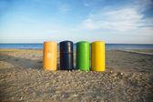 Garbage barrels at beach — Stock Photo
