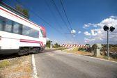 Level crossing train — Stock Photo