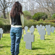 Woman stand at a cemetery — Stock Photo