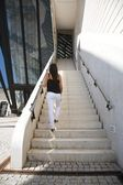 White jeans woman at stairs — Stock Photo