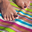 Foto Stock: Varnished toenails