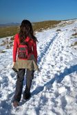 Walking on long snow path — Stock Photo