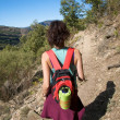 Red rucksack woman walking in mountain — Stock Photo