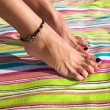 Woman ankle with bracelet — Stock Photo