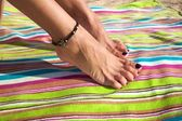 Woman ankle with bracelet — Stockfoto