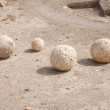 Stock Photo: Ancient catapult balls