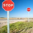 Two stop signals - Stock Photo