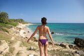 Back purple bikini woman — Stock Photo