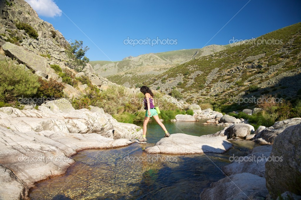 Woman on a river at Gredos mountains in Avila Spain — Stock Photo #6704028