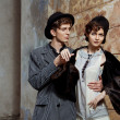 Retro styled fashion portrait of a young couple. - Stock Photo