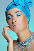 Young woman in blue touching health skin of face — Stock Photo