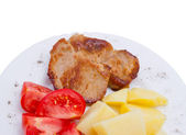 Meat with potato and tomato on plate — Stock Photo