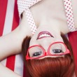 Cheerful red haired girl - Stock Photo