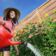Beautiful woman gardener — Foto Stock